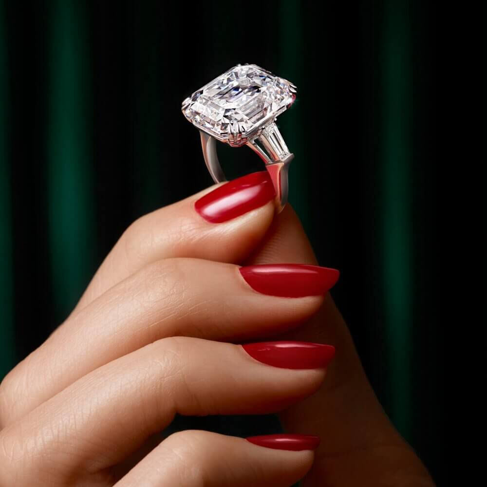 Model holding a Graff emerald cut diamond ring