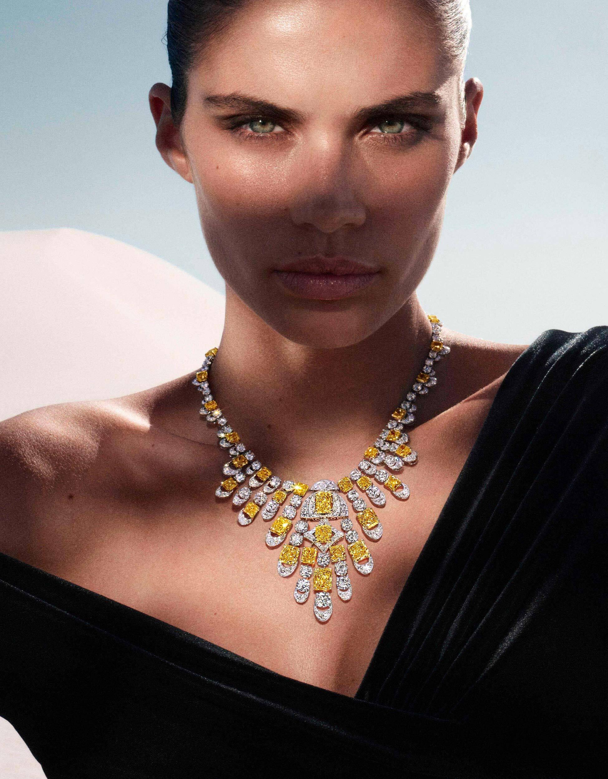 Sara Sampaio wears Graff Night Moon yellow and white diamond necklace, in a desert