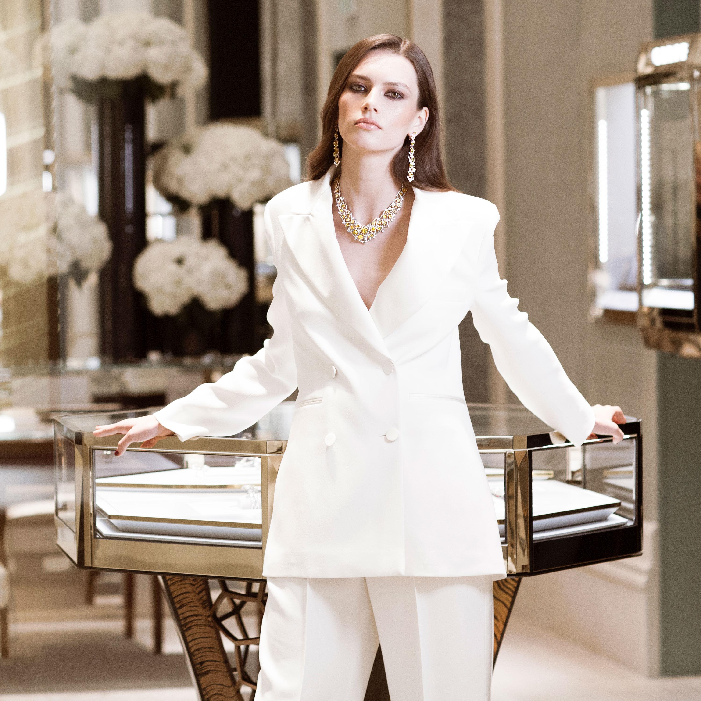 Model wears Graff diamond jewellery in a Graff boutique