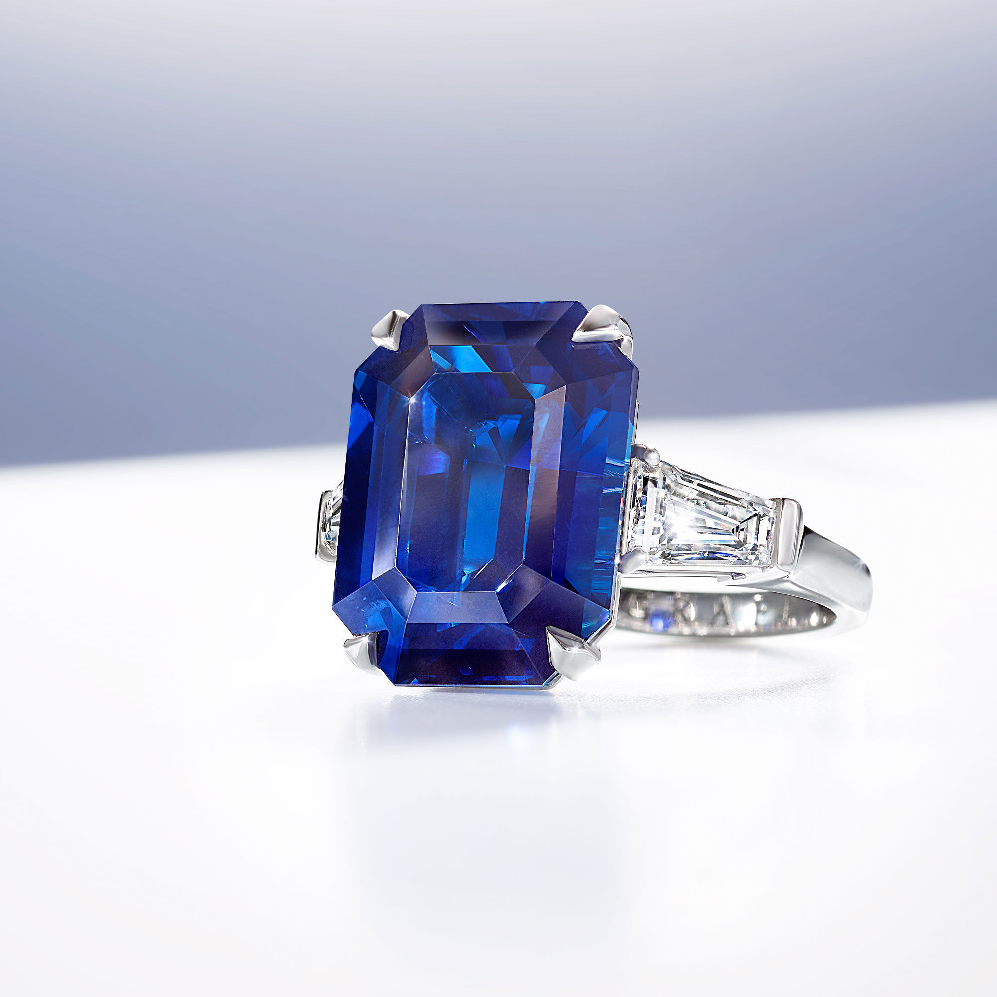 An emerald cut sapphire and white diamond ring by Graff