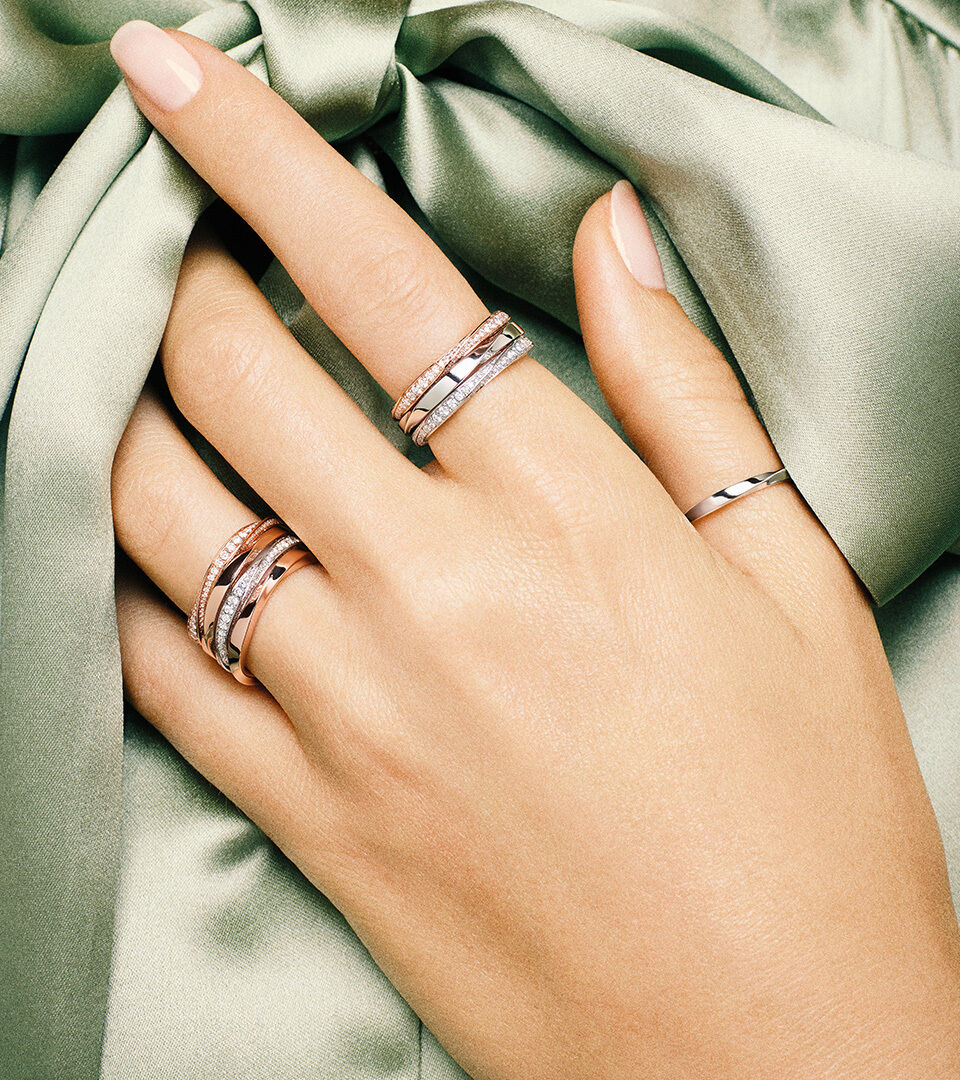 Close up of a model's hand wearing Graff Spiral jewellery collection rings