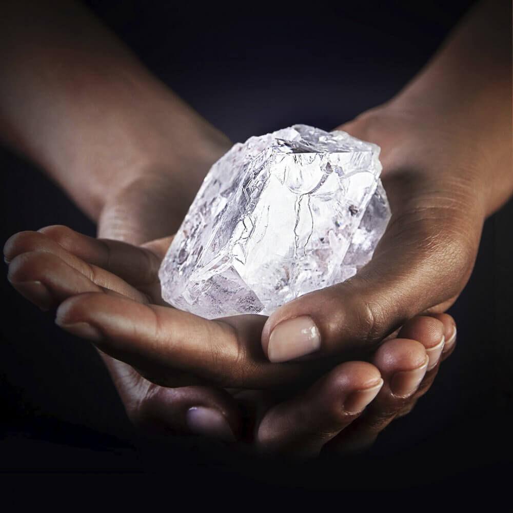 lesedi la rona rough diamond in the hands of model