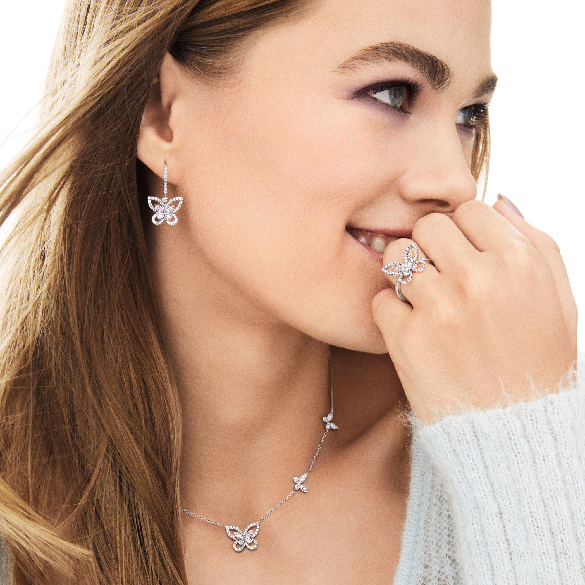 Model wearing earrings, pendant and ring from the Butterfly Silhouette Collection