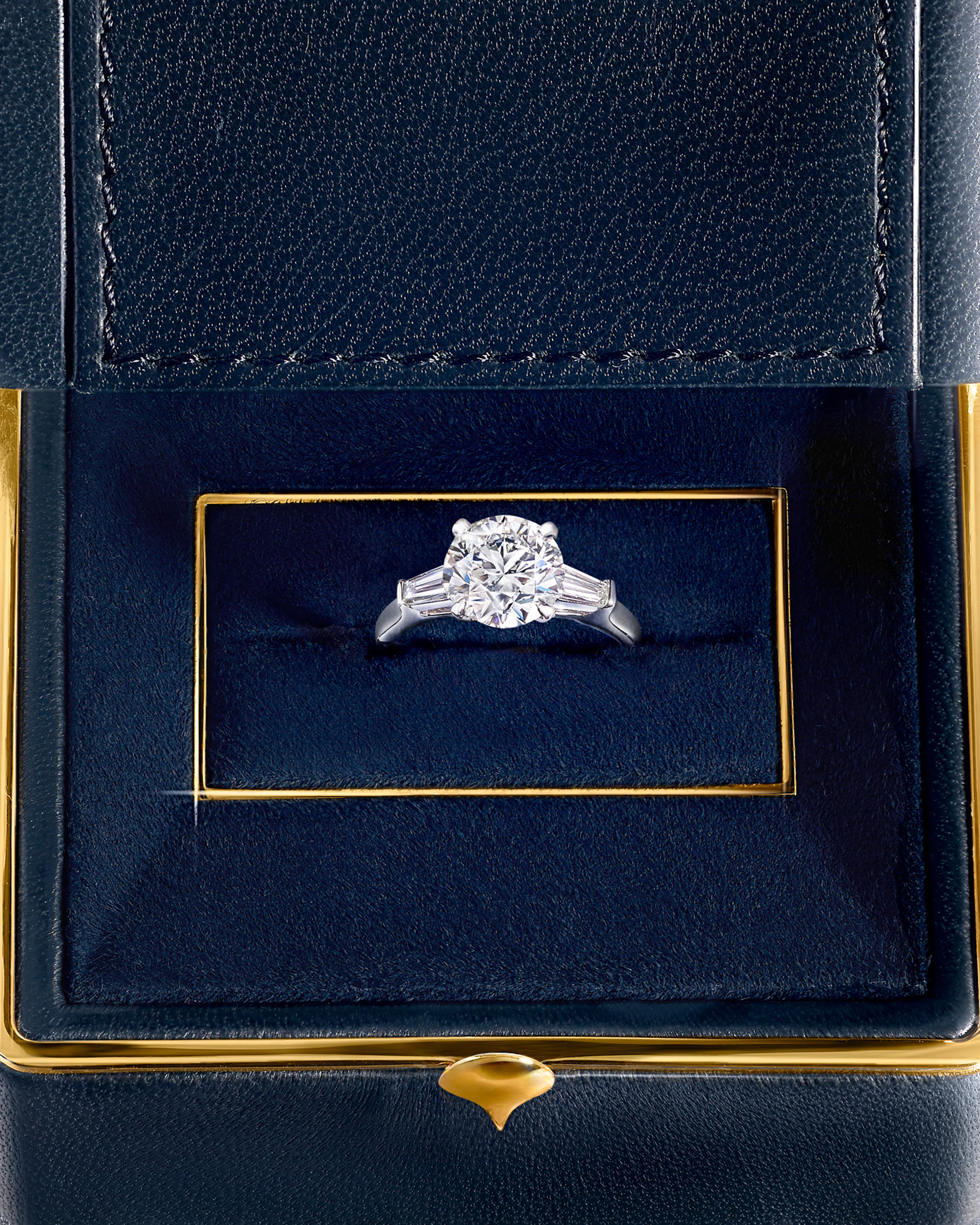 Close up of a Graff diamond engagement ring in a jewellery box