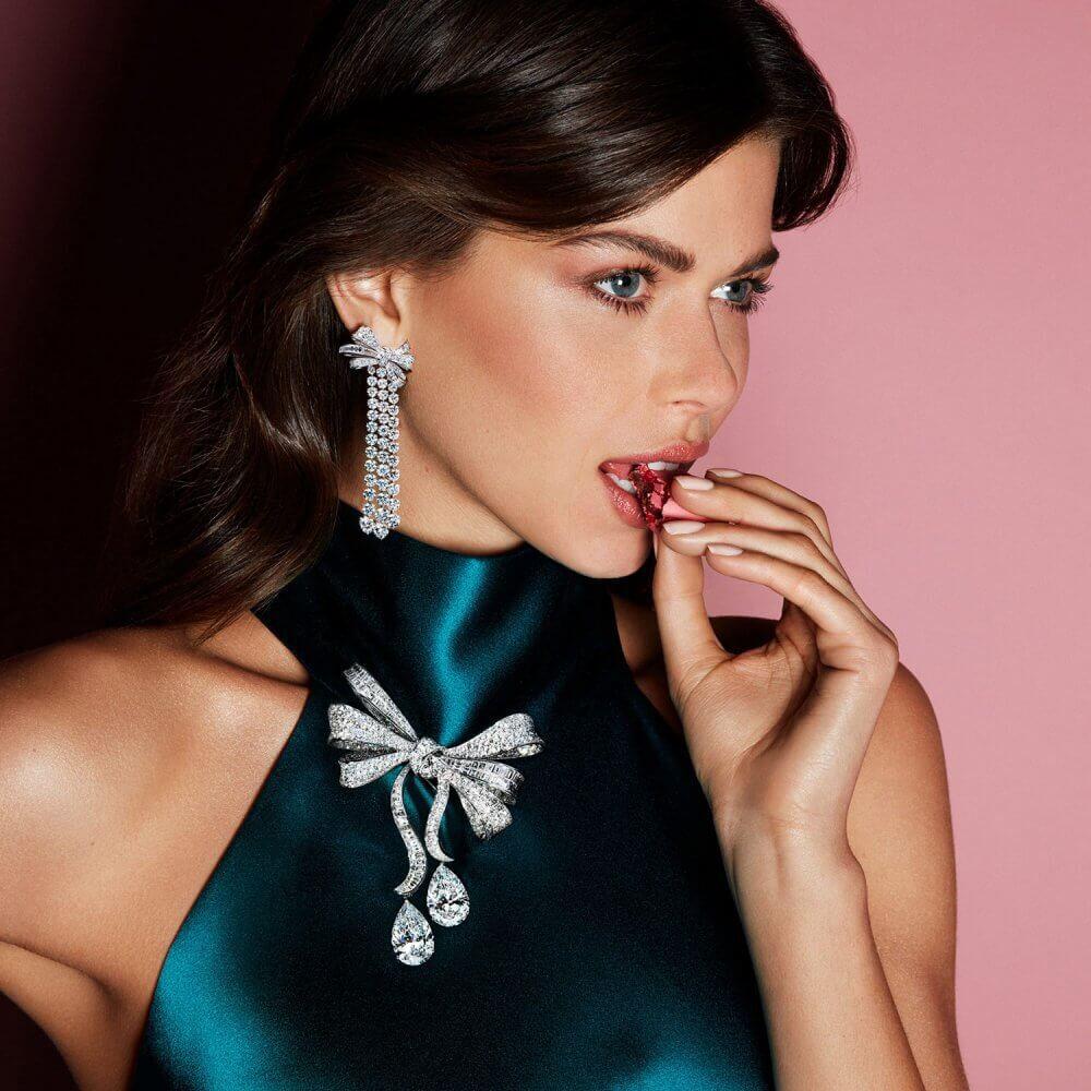 Model wears Graff Bow jewellery collation diamond earrings and brooch