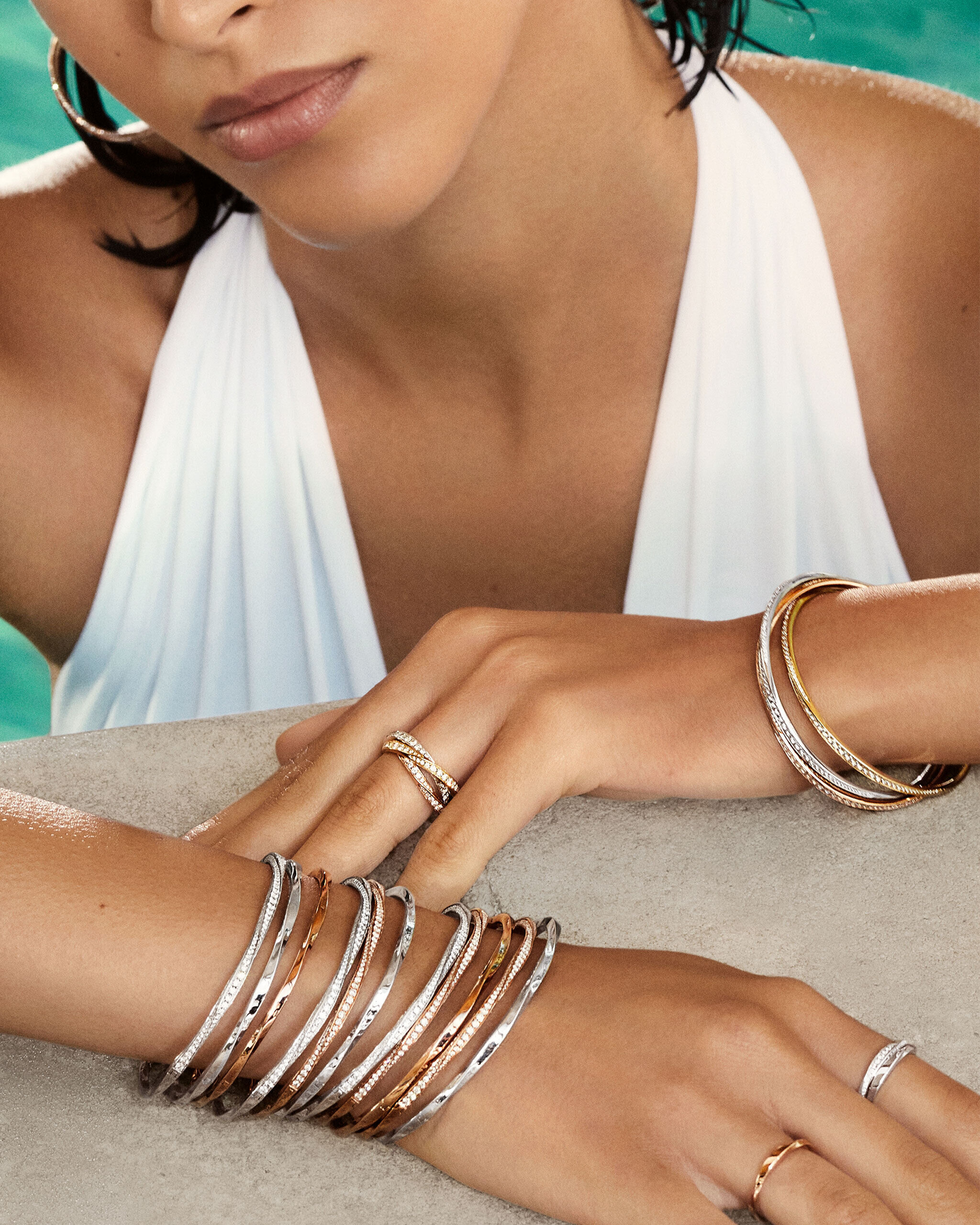 Model wears Graff Spiral collection diamond jewellery in a pool
