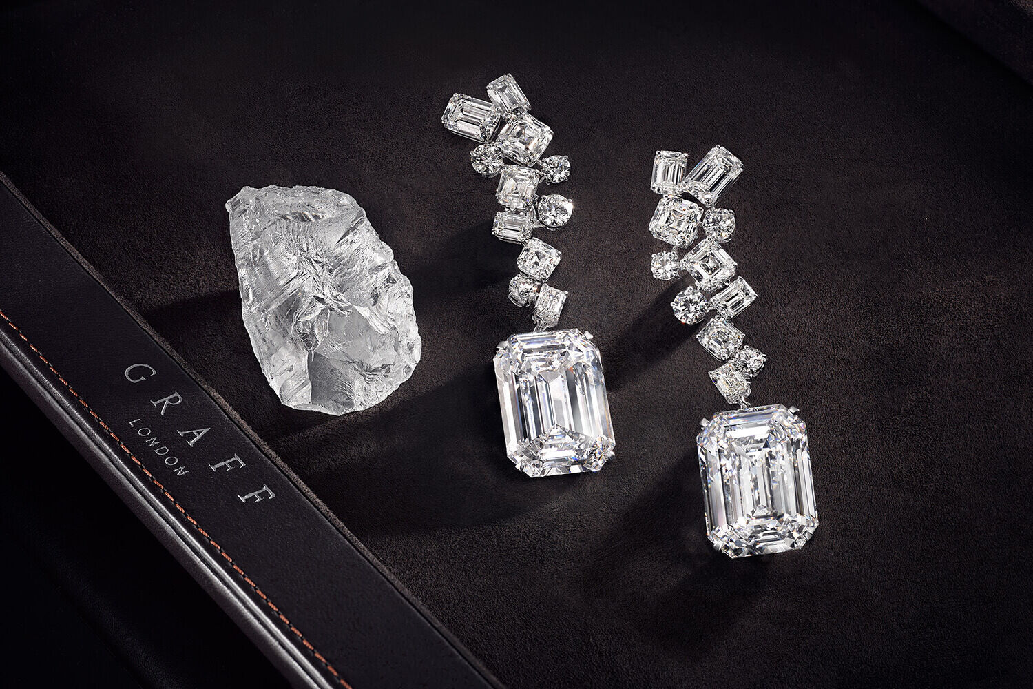 The Graff Eternal Twins - two identical D Flawless emerald cut diamonds weighing 50.23 carats each and the rough stone