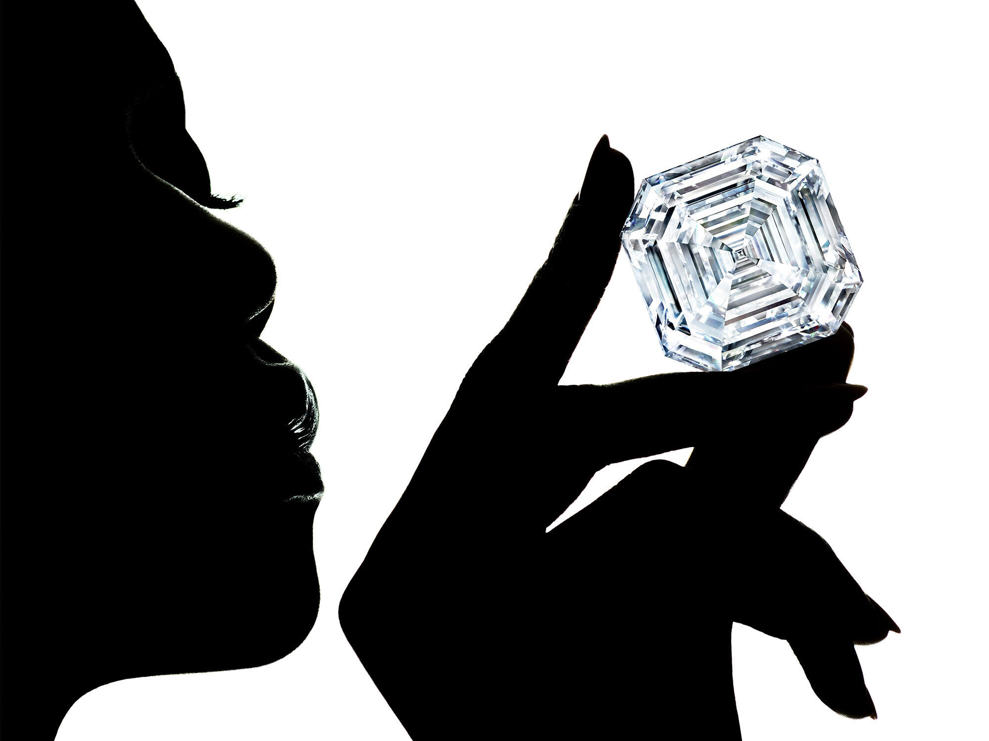 Shadow of model holding the Graff Lesedi La Rona diamond.