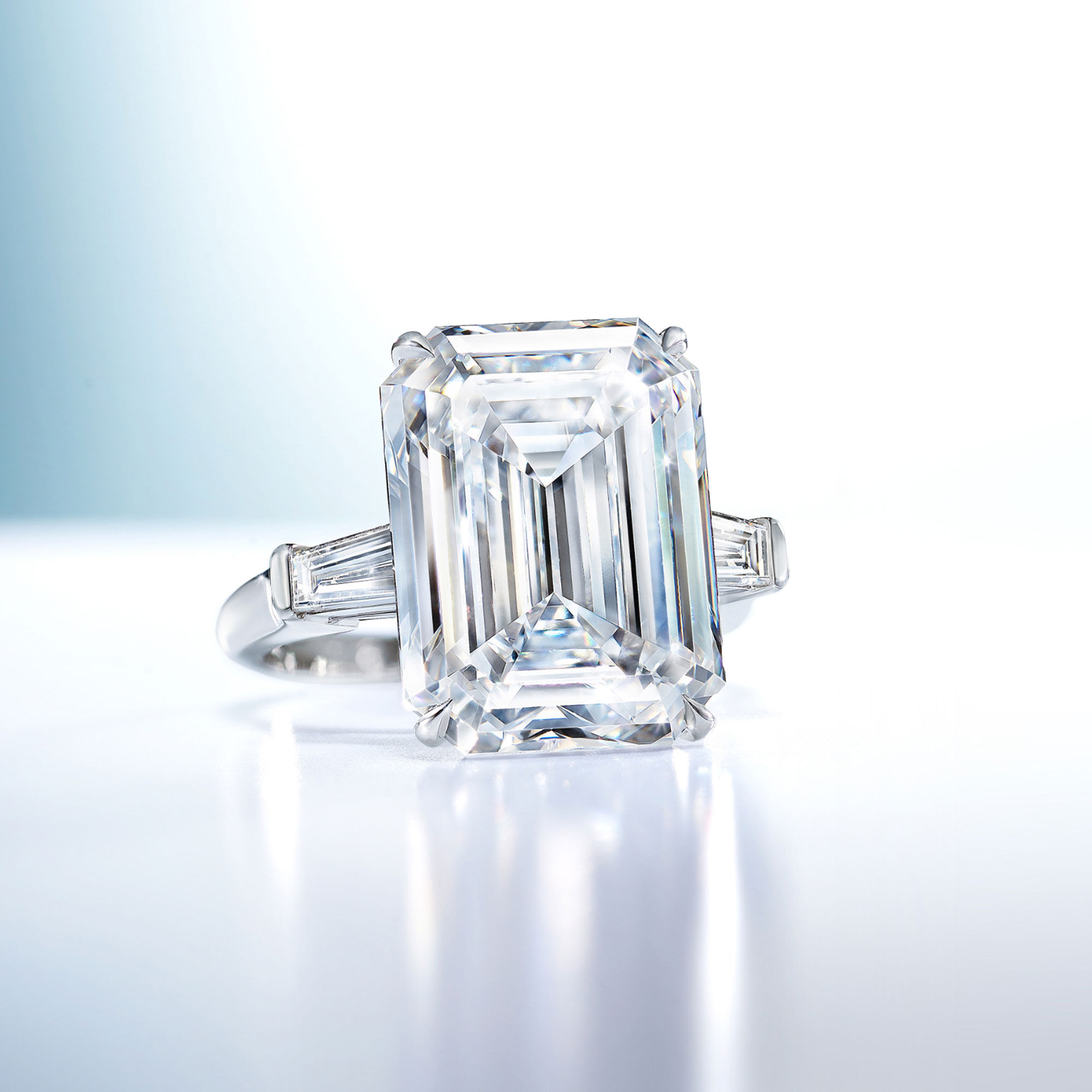 An emerald cut white diamond ring with baguette cut side stones