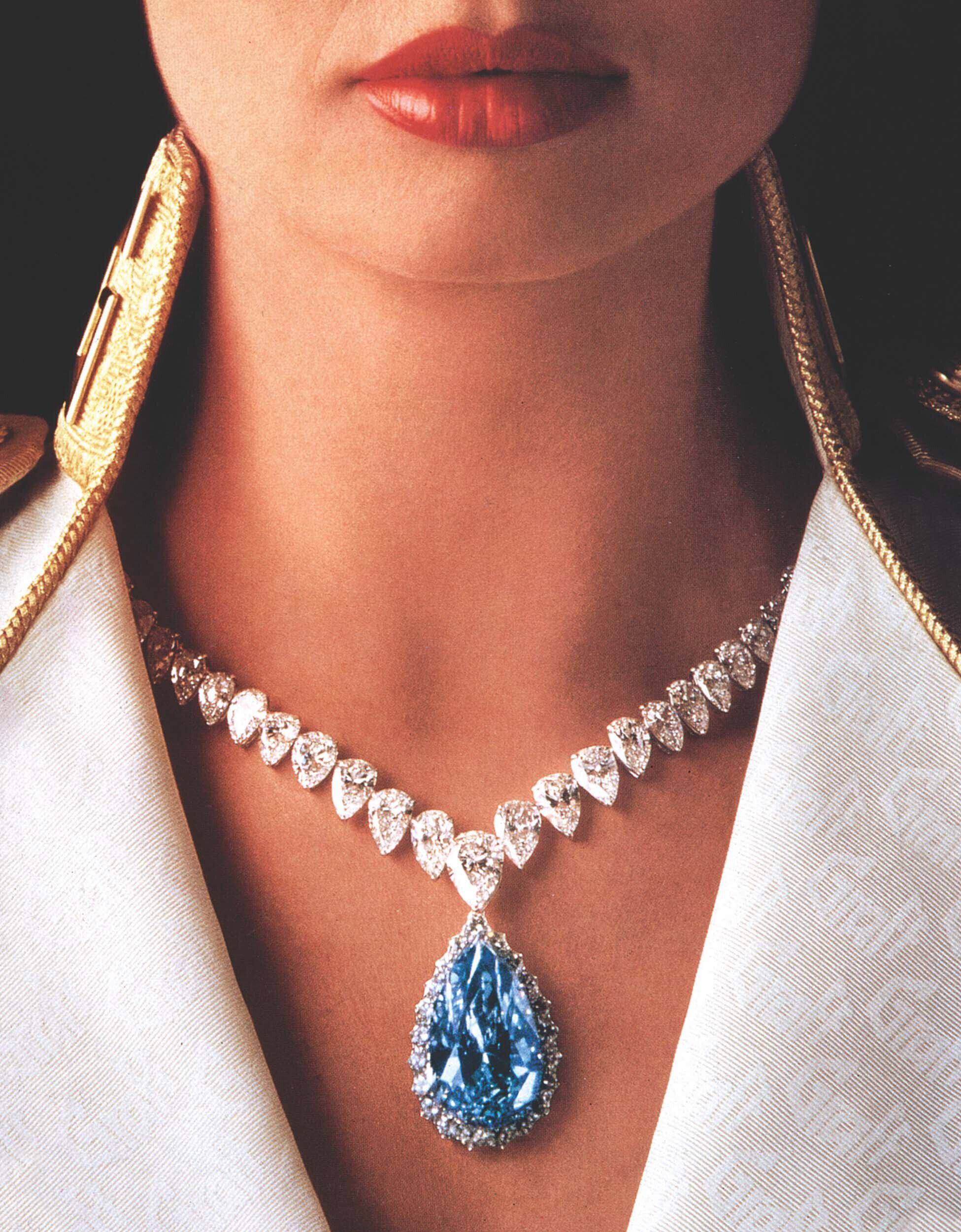 Close up of a model wearing a Graff blue and white diamond high jewellery necklace
