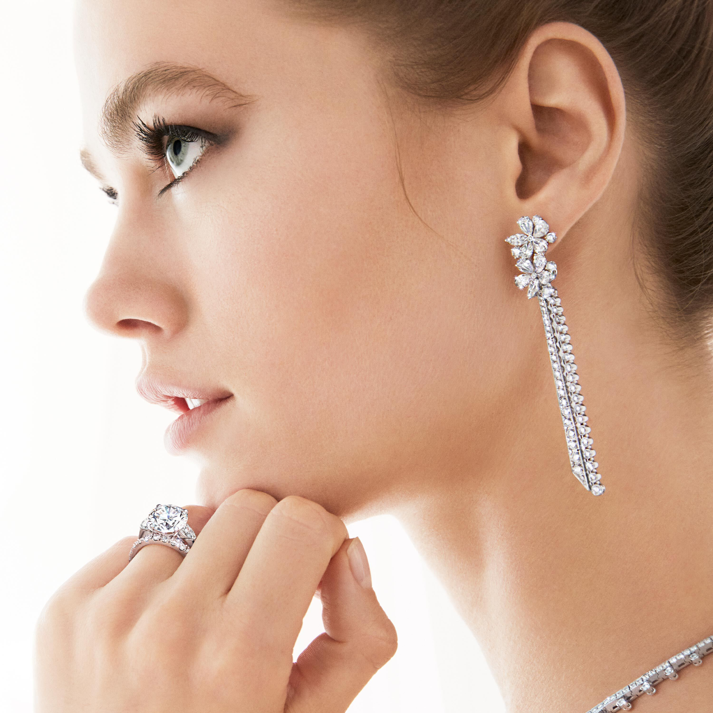 Close up of model wearing Graff bridal diamond jewellery