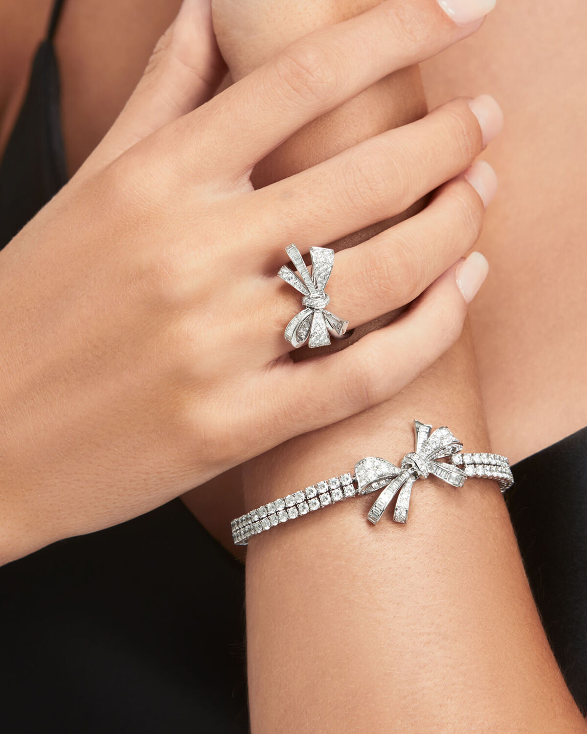 Close up of a model wears Graff Bow collection diamond jewellery