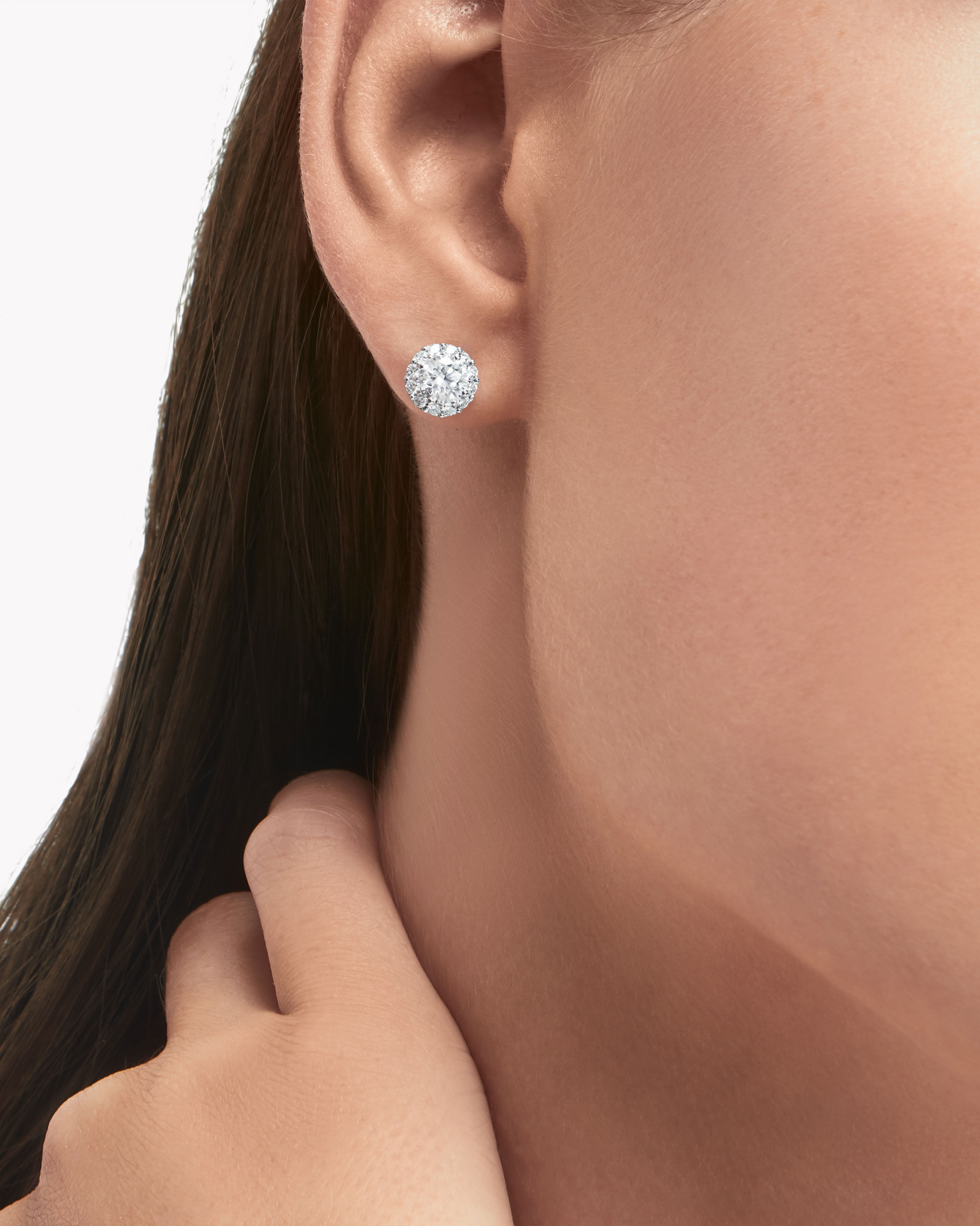 Close up of a model wears Graff jewellery collection earrings