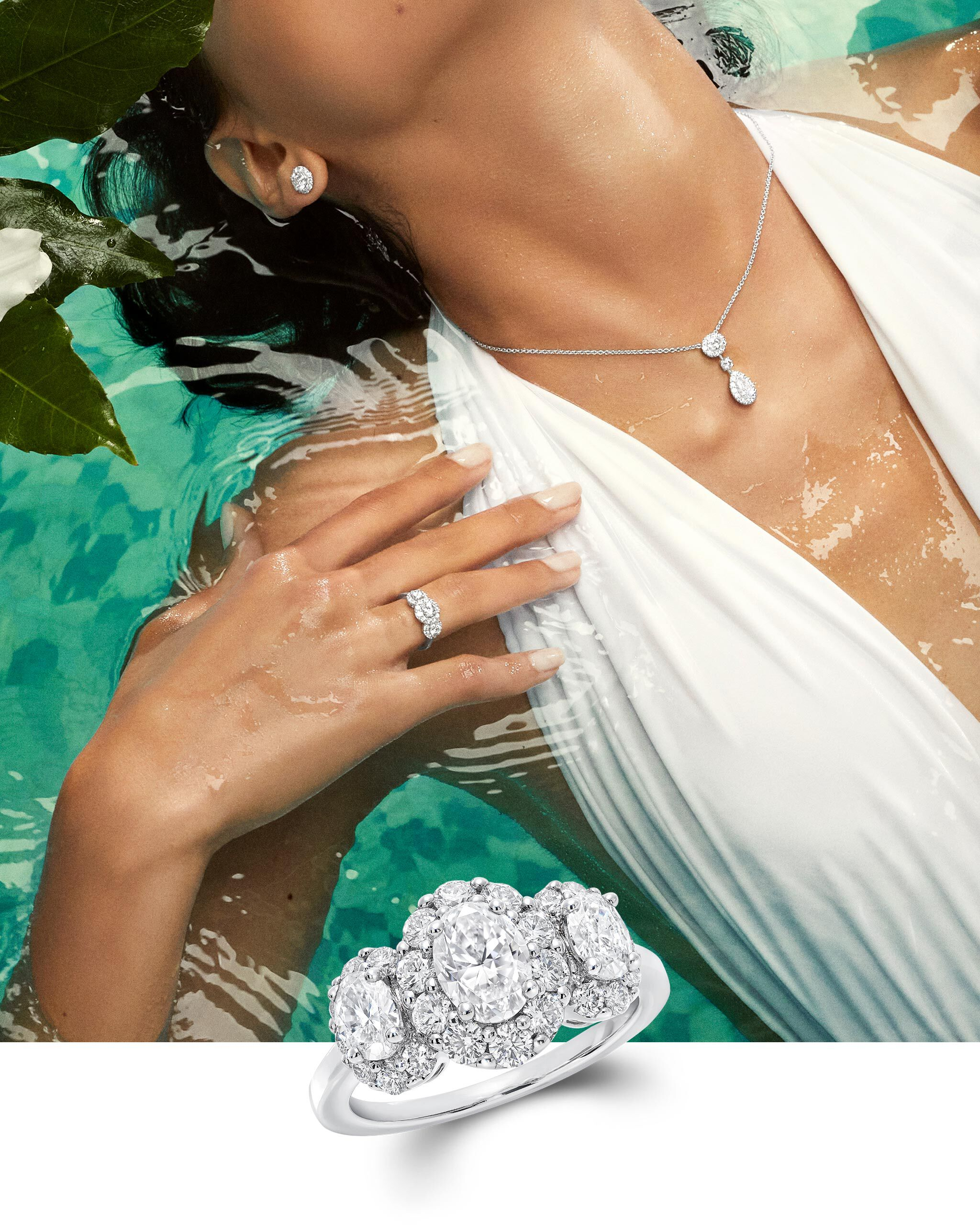 Model wears Graff Icon collection diamond jewellery in a pool
