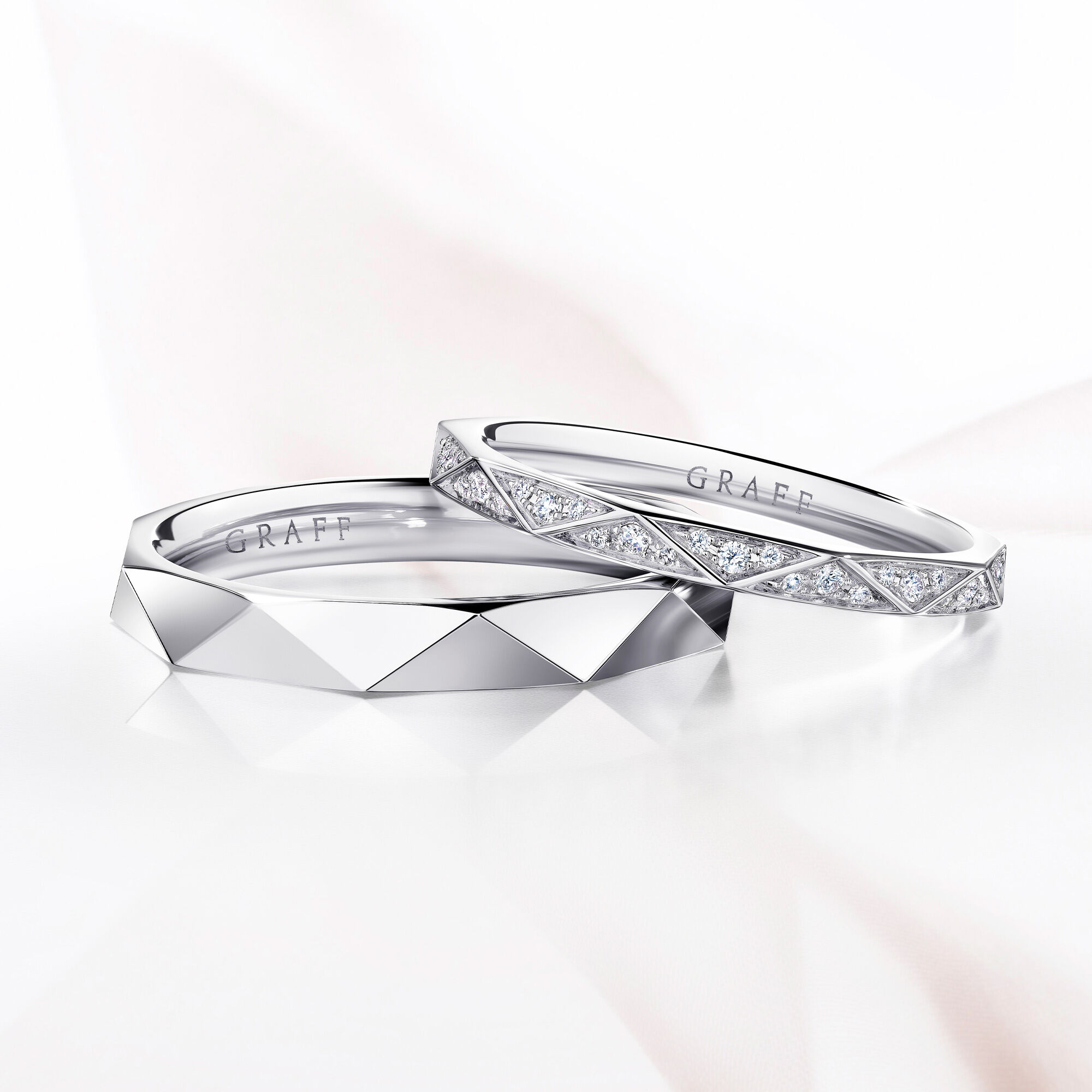Close up of two Laurence Graff Signature wedding bands
