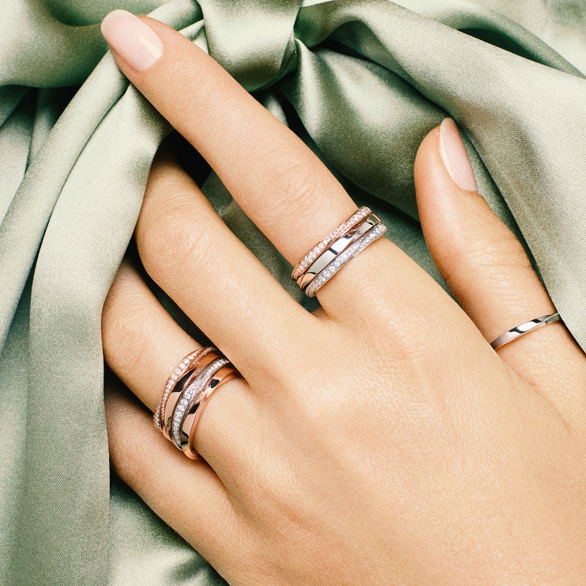 Close up of a hand wearing Graff Spiral collection diamond jewellery