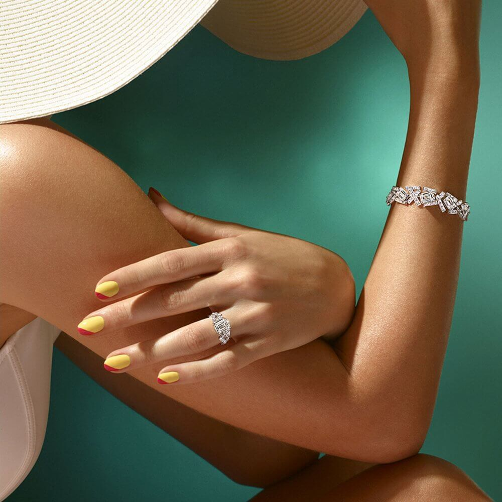 A lady wearing a Graff Diamond Threads Classic bracelet and ring