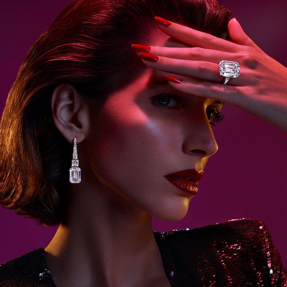 Graff D Flawless emerald cut diamond ring and high jewellery emerald cut diamond earrings worn by model