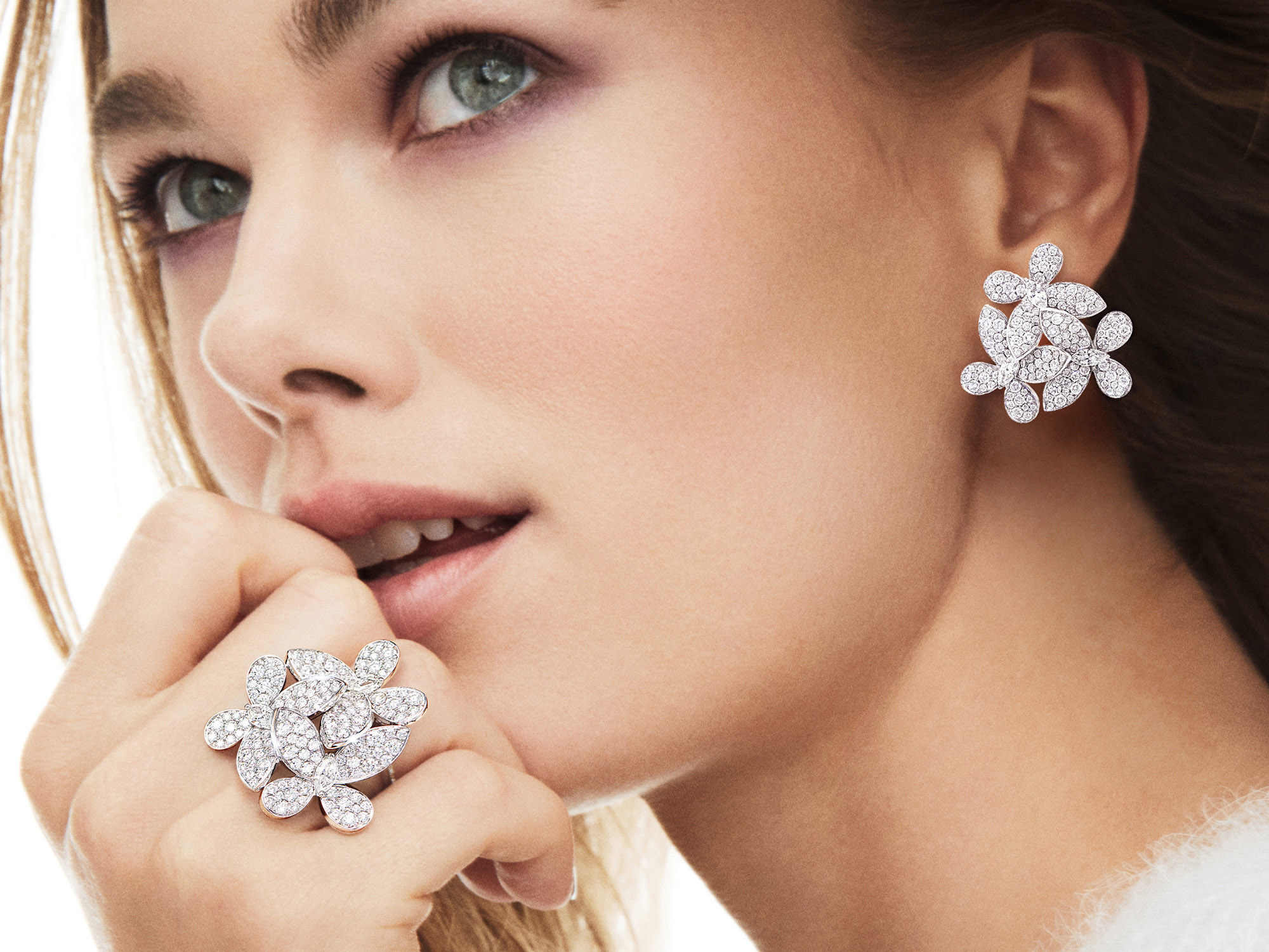 Model Wearing Graff Triple Pavé Butterfly Diamond RingTriple Pavé Butterfly Diamond Earrings.