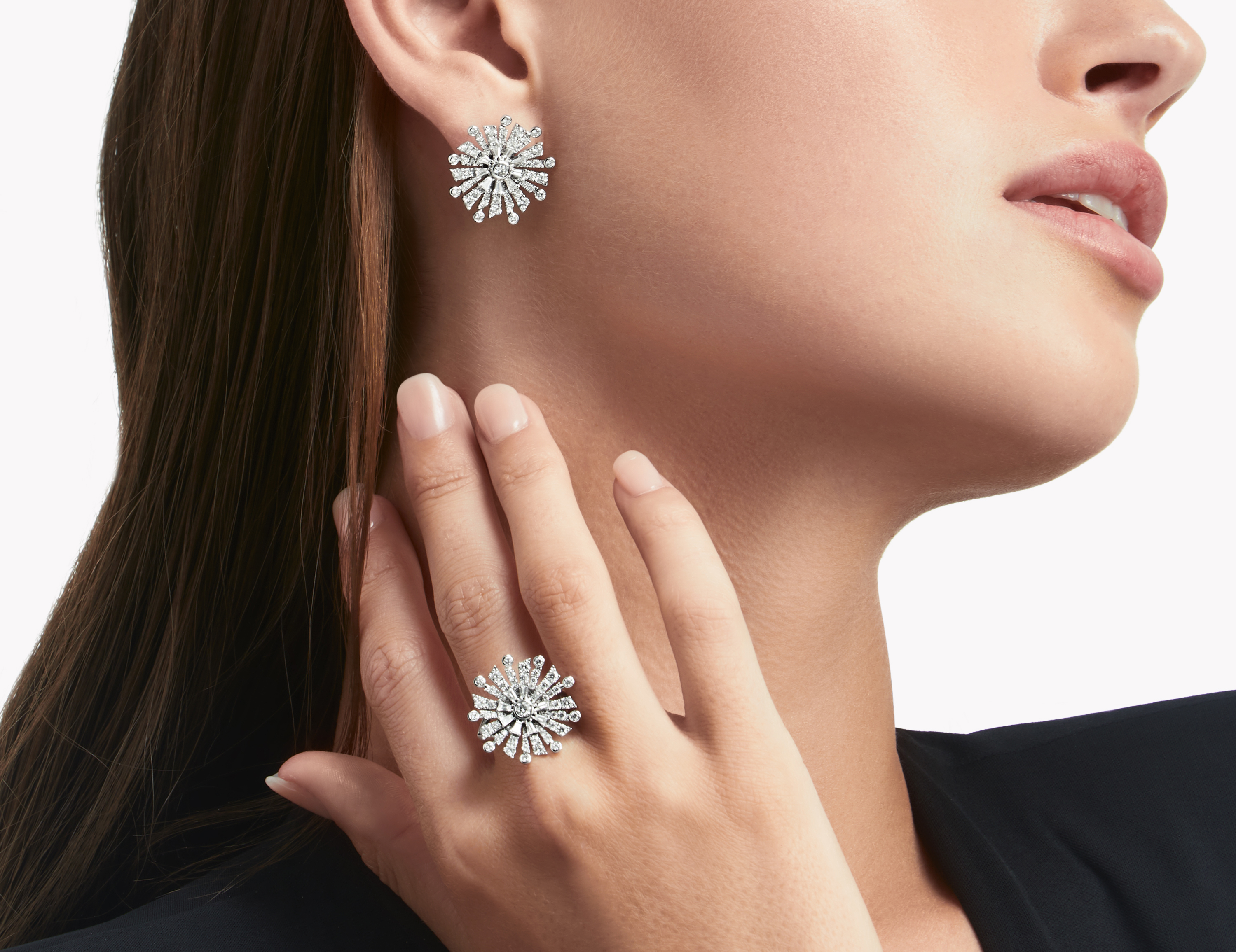 Model wears Graff jewellery collection Diamond Stud Earrings and Diamond Ring